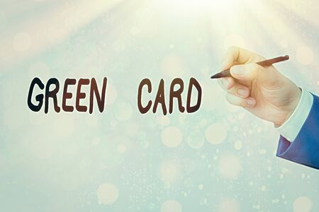 Conceptual hand writing showing Green Card. Concept meaning permit allowing a foreign national to live permanently in the US