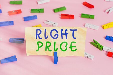 Text sign showing Right Price. Business photo showcasing the amount of money that it is reasonable for the product Colored clothespin papers empty reminder pink floor background office pin Фото со стока