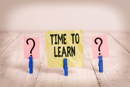 Text sign showing Time To Learn. Business photo text the need to get knowledge or understanding of facts and ideas Scribbled and crumbling sheet with paper clips placed on the wooden table