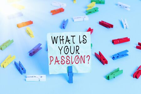 Writing note showing What Is Your Passion Question. Business concept for asking about his strong and barely controllable emotion Colored clothespin papers empty reminder blue floor officepin