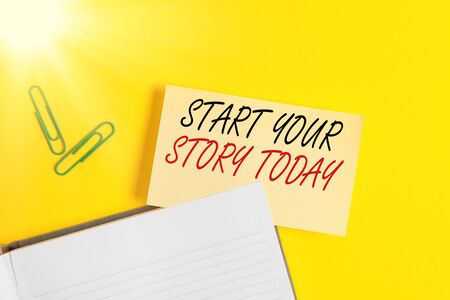 Writing note showing Start Your Story Today. Business concept for work hard on yourself and begin from this moment Empty orange paper with copy space on the yellow table Zdjęcie Seryjne