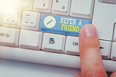 Writing note showing Refer A Friend. Business concept for direct someone to another or send him something like gift