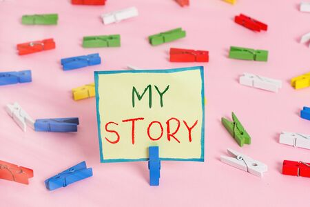 Text sign showing My Story. Business photo text the things or situations that have happened to someone in life Colored clothespin papers empty reminder pink floor background office pin