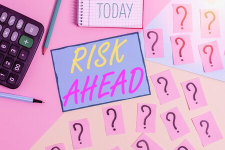 Text sign showing Risk Ahead. Business photo text A probability or threat of damage, injury, liability, loss Mathematics stuff and writing equipment above pastel colours background 版權商用圖片