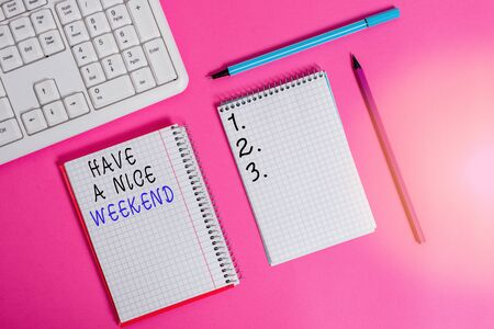 Writing note showing Have A Nice Weekend. Business concept for wishing someone that something nice happen holiday Writing equipments and computer stuffs placed above colored plain table