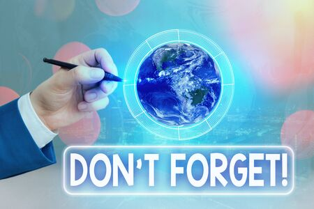 Conceptual hand writing showing Dont Forget. Concept meaning used to remind someone about an important fact