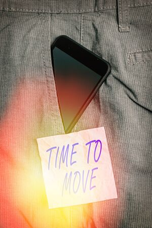 Text sign showing Time To Move. Business photo showcasing change in the same way or to reflect on what is current Smartphone device inside formal work trousers front pocket near note paper