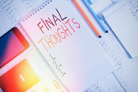 Handwriting text Final Thoughts. Conceptual photo the conclusion or last few sentences within your conclusion Smartphone man wallet clips notebook pens ballpoints note pad wooden table
