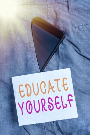 Writing note showing Educate Yourself. Business concept for prepare oneself or someone in a particular area or subject Smartphone device inside trousers front pocket note paper Stockfoto