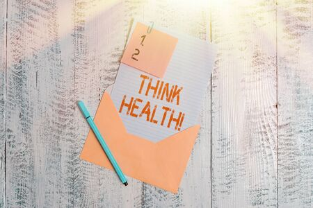 Text sign showing Think Health. Business photo text state of complete physical mental and social well being Envelope blank sheet letter paper sticky note ballpoint wooden background