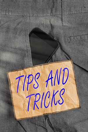 Conceptual hand writing showing Tips And Tricks. Concept meaning piece of inside facts specially in betting or investing Smartphone device inside trousers front pocket note paper