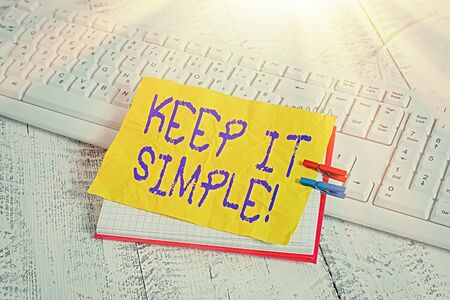 Conceptual hand writing showing Keep It Simple. Concept meaning ask something easy understand not go into too much detail notebook reminder clothespin with pinned sheet light wooden