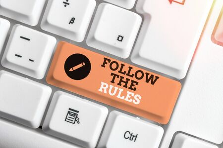 Handwriting text writing Follow The Rules. Conceptual photo go with regulations governing conduct or procedure