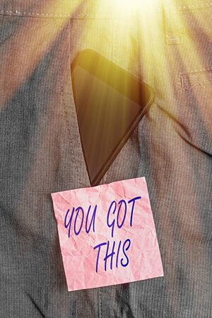 Text sign showing You Got This. Business photo showcasing to encourage someone to succeed in dealing with something Smartphone device inside formal work trousers front pocket near note paper