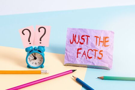 Text sign showing Just The Facts. Business photo showcasing to have the correct information about the exact details Mini size alarm clock beside stationary placed tilted on pastel backdrop