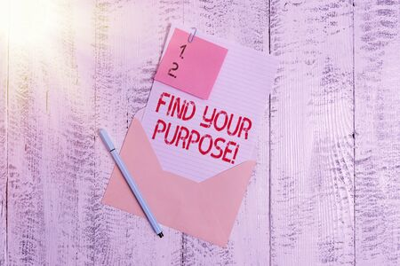 Text sign showing Find Your Purpose. Business photo text reason for something is done or for which still exists Envelope blank sheet letter paper sticky note ballpoint wooden background