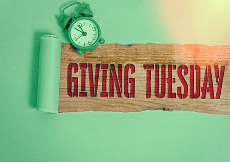 Handwriting text writing Giving Tuesday. Conceptual photo international day of charitable giving Hashtag activism