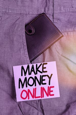 Writing note showing Make Money Online. Business concept for making profit using internet like freelancing or marketing Small wallet inside trouser front pocket near notation paper