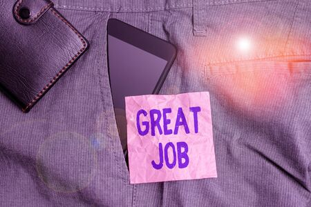 Text sign showing Great Job. Business photo showcasing used praising someone for something they have done very well Smartphone device inside trousers front pocket with wallet and note paper 版權商用圖片