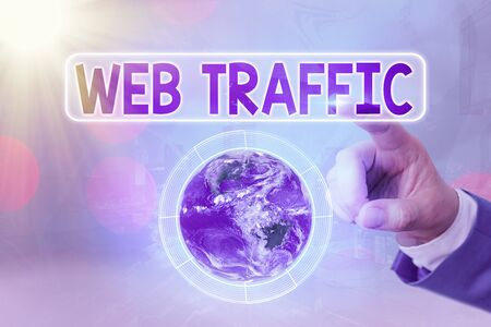 Writing note showing Web Traffic. Business concept for the amount of data sent and received by visitors to a website