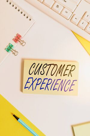 Writing note showing Customer Experience. Business concept for product of interaction between organization and buyer Flat lay with pc keyboard and copy space for text messages