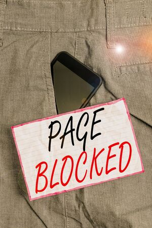 Text sign showing Page Blocked. Business photo showcasing Users are prevented from being accessed or used the webpage Smartphone device inside formal work trousers front pocket near note paper 版權商用圖片