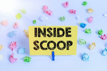 Handwriting text Inside Scoop. Conceptual photo Information that only an insider would have Real information Colored crumpled papers empty reminder white floor background clothespin