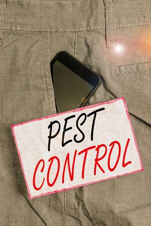 Text sign showing Pest Control. Business photo showcasing management of a species that impacts adversely on human Smartphone device inside formal work trousers front pocket near note paper