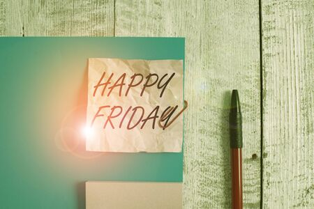 Text sign showing Happy Friday. Business photo showcasing Greetings on Fridays because it is the end of the work week Wrinkle paper and cardboard plus stationary placed above wooden background Banco de Imagens
