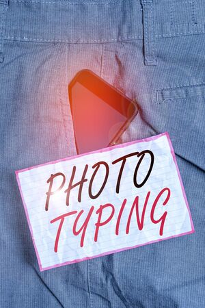 Text sign showing Photo Typing. Business photo showcasing metal printing block use to reproduce a photograph in printing Smartphone device inside formal work trousers front pocket near note paper