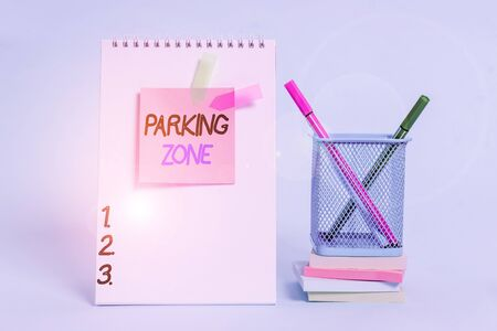 Text sign showing Parking Zone. Business photo showcasing a space where an automobile can be parked Allowed to parked Spiral notebook sticky note banners stacked pads pens holder pastel back