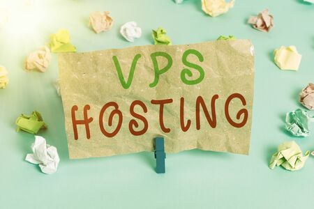 Text sign showing Vps Hosting. Business photo text mimics a dedicated server within a shared hosting environment Colored crumpled papers empty reminder blue floor background clothespin Banco de Imagens