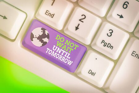 Writing note showing Do Not Wait Until Tomorrow. Business concept for needed to do it right away Urgent Better do now Foto de archivo