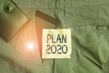 Handwriting text writing Plan 2020. Conceptual photo detailed proposal for doing or achieving something next year Smartphone device inside trousers front pocket with wallet and note paper