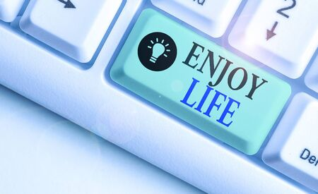 Writing note showing Enjoy Life. Business concept for having a happy point of view and a positive outlook in life