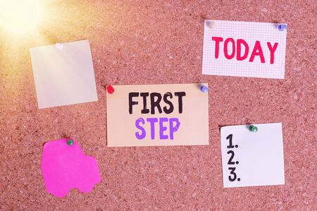Conceptual hand writing showing First Step. Concept meaning The first of a series of actions Act of starting something Corkboard size paper thumbtack sheet billboard notice board Stock Photo