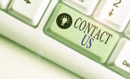 Writing note showing Contact Us. Business concept for Term used to describe reaching out with the business or demonstrating