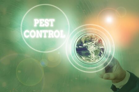 Writing note showing Pest Control. Business concept for management of a species that impacts adversely on human
