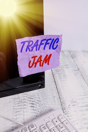 Conceptual hand writing showing Traffic Jam. Concept meaning a large number of vehicles close together and unable to move Notation paper computer monitor screen near white keyboard Imagens