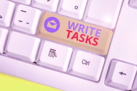 Writing note showing Write Tasks. Business concept for assigned piece of work often to be finished within certain time Foto de archivo