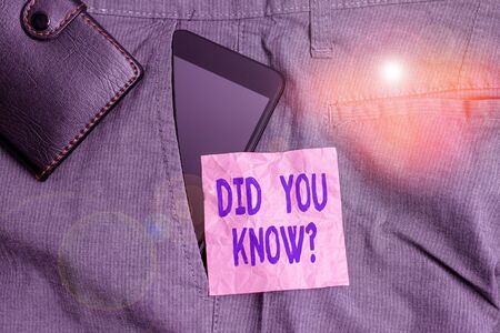 Text sign showing Did You Know Question. Business photo showcasing when you are asking someone if they know fact or event Smartphone device inside trousers front pocket with wallet and note paper