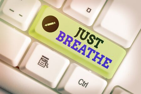Writing note showing Just Breathe. Business concept for Take a break in a stressful day To overcome difficulties Relax