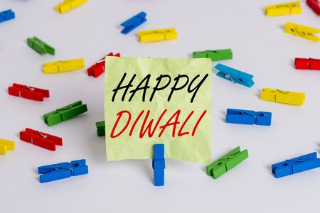 Writing note showing Happy Diwali. Business concept for festival of lights that celebrated by millions of Hindus Colored clothespin papers empty reminder white floor background office