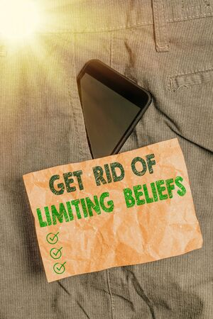 Writing note showing Get Rid Of Limiting Beliefs. Business concept for remove negative beliefs and think positively Smartphone device inside trousers front pocket note paper
