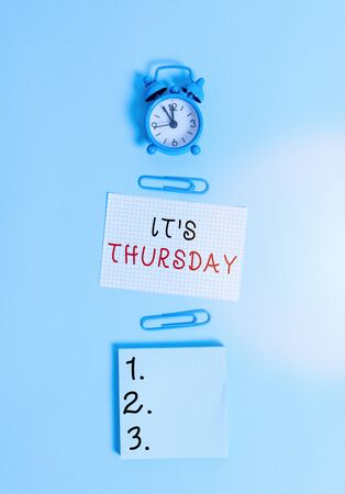Text sign showing Its Thursday. Business photo text day of the week before Friday and following Wednesday Alarm clock squared blank paper sheet notepad clips colored background