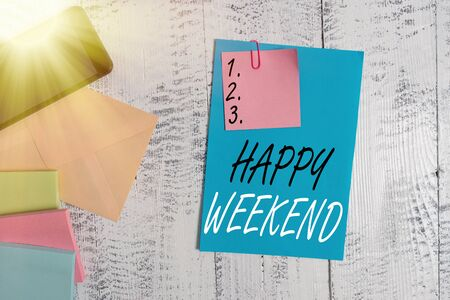 Conceptual hand writing showing Happy Weekend. Concept meaning something nice has happened or they feel satisfied with life Envelope paper sheet smartphone wooden vintage background
