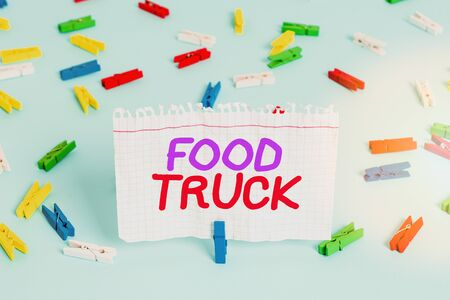 Conceptual hand writing showing Food Truck. Concept meaning a large vehicle with facilities for cooking and selling food Colored clothespin paper empty reminder blue floor officepin