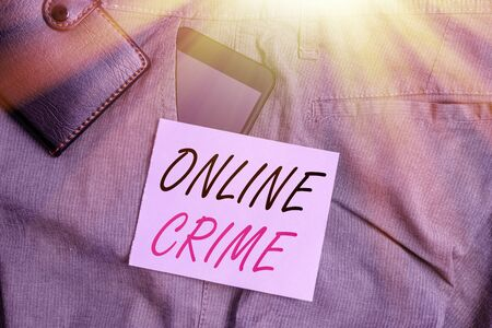 Writing note showing Online Crime. Business concept for crime or illegal online activity committed on the Internet Smartphone device inside trousers front pocket with wallet