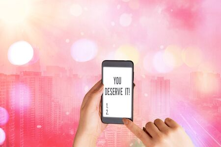 Text sign showing You Deserve It. Business photo text should have it because of their qualities or actions
