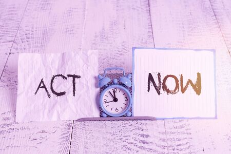 Conceptual hand writing showing Act Now. Concept meaning fulfil the function or serve the purpose of Take action Do something Alarm clock tilted above buffer wire in front of notepaper